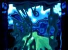 The world seen through a blue glass brick